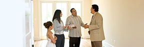 Family with real estate agent
