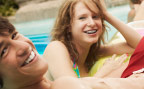 Young people relaxing in swimming pool
