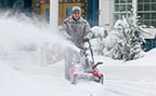 Man snowblowing snow